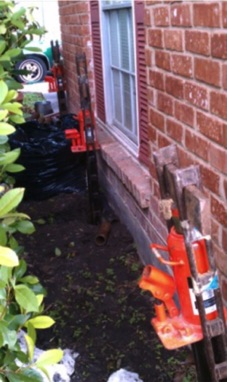 Several steel piers alongside house with very minimal disturbance to landscaping...